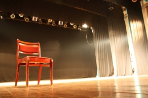 red chair on theatre stage
